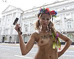FEMEN Activist poses topless with a hammer.jpg