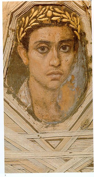 Fayum mummy portraits - Detail of a portrait within its mummy wrappings, Metropolitan Museum of Art, discovered by Flinders Petrie in 1911.