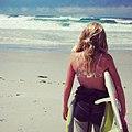 Female surfer at the beach.jpg