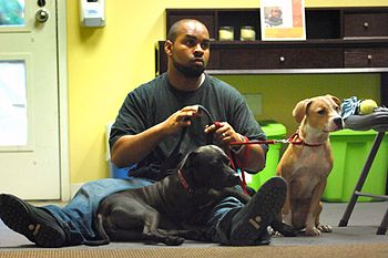 Capt. Lawrence Minnis sits with his two adopte...