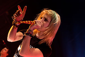 Hayley Williams performing with Paramore at th...
