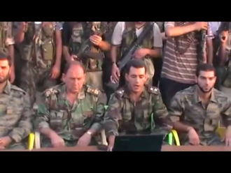 A colonel (left) and a first lieutenant (right) in the FSA announce the formation of the Conquest Brigade, part of the FSA in Tell Rifaat, north of Aleppo, 31 July 2012. Formation of Conquest Brigade in Tell Rifaat.png