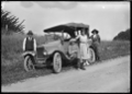 Four people with a car, motoring near Whangarei, 1923 ATLIB 300156.png