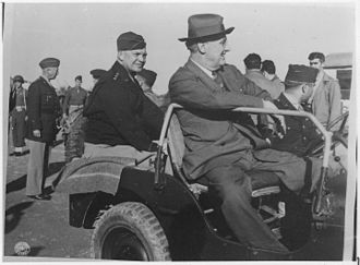 Dwight D. Eisenhower - General Eisenhower, General Patton (standing to the left) and President Roosevelt in Sicily, 1943
