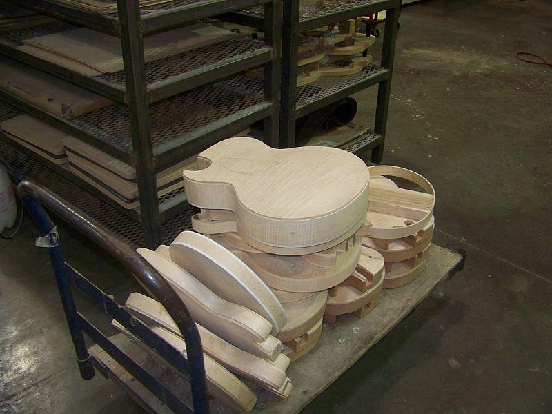 File:GMFT3-6 pile of guitar bodies, in work in process.jpg
