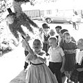 Girl striking pinata in carport of California home 1961 - 2.jpg