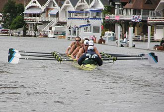 Henley Royal Regatta - Green Lake Crew, USA racing, with the pilings and floating booms seen in the background