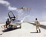 HL-10 on Lakebed with B-52 flyby - GPN-2000-000201.jpg