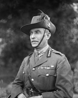 Head and shoulders of man in Army uniform with Sam Brown belt and slouch hat with emu feathers.