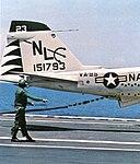 Hook runner approaches KA-6D Intruder of VA-95 aboard USS Coral Sea (CVA-43), in 1973.jpg