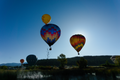 Hot air balloons over steaming river.png