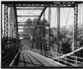 INTERIOR OF SPAN FROM DECK, VIEW TO NORTH - Ouaquaga Bridge, Dutchtown Road, spanning Susquehanna River, Ouaquaga, Broome County, NY HAER NY,4-OUAQ,1-8.tif