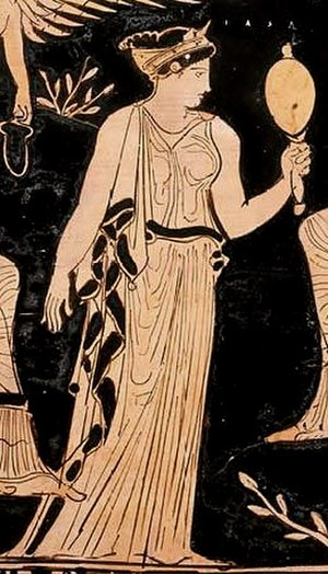 Iaso - Detail of Iaso, the goddess of healing, from a scene depicting a group of goddesses. Iaso gazes at herself in a mirror, presumably as a sign of good health.