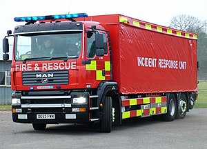 Emergency vehicle equipment in the United Kingdom - An Incident Response Unit operated by Norfolk Fire and Rescue Service with a blue lightbar on top, alternately flashing LED lights on the front, and flashing headlights. This vehicle is part of the New Dimension programme and consequently does not carry any insignia of Norfolk Fire and Rescue Service.