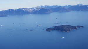 Inussulik Bay - Aerial view of the southern part of the bay, with Ikermiut island in the foreground, and Nuussuaq Peninsula in the background.