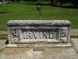 Irving stone marker, located where the post office once stood.