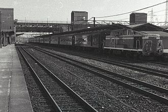 Gantoku Line - A morning Gantoku Line train at Iwakuni Station, headed by a class DE10 diesel locomotive, circa 1976