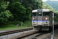 JNR 113 refurbished C4 set San'in Main Line (Sagano Line) local near Arashiyama.jpg