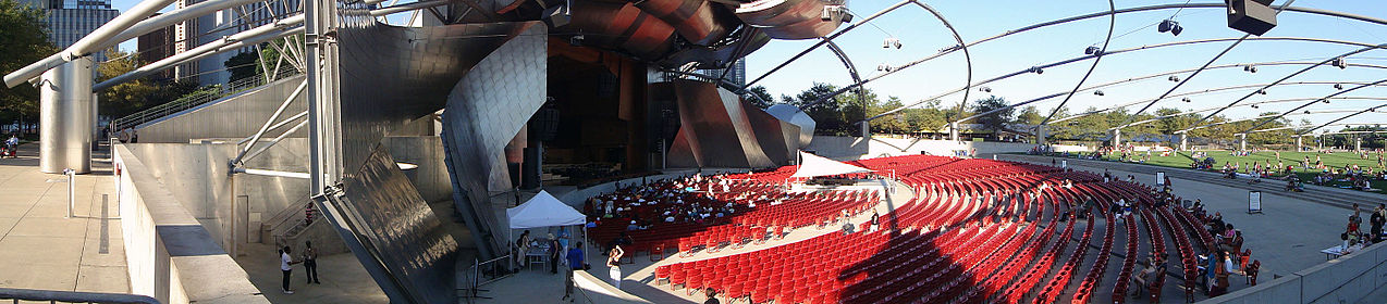 Panoramic shot of the Jay Pritzker Pavilion, showing the stage area to the garden seating area.