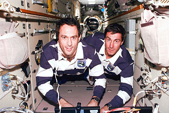 Sergei Krikalev - Sergei Krikalev with James H. Newman on the left during STS-88