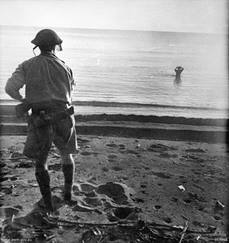 Japanese prisoners of war in World War II - A Japanese soldier in the sea off Cape Endaiadere, New Guinea, on 18 December 1942 holding a hand grenade to his head moments before using it to commit suicide. The Australian soldier on the beach had called on him to surrender.