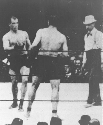 Tom Sharkey - Sharkey (left) during his fight with Jeffries