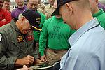 Jimmy Buffett autographs a Sailor's guitar DVIDS89459.jpg