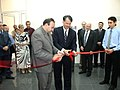 John M. Evans cutting a ribbon with Levon Mkrtchyan (2006).jpg