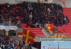 Helsingborgs IF - Helsingborg supporters displaying the red and yellow Scanian flag
