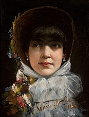 A young woman with bangs.