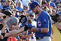Kris Bryant signing autographs during his rehab assignment against Omaha (30447672248).jpg