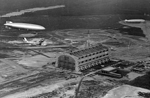Lakehurst Hangar No. 1 - Image: LZ 129 Hindenburg with RD 4 over Lakehurst May 1936