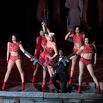 "Americano (song) - Gaga and her dancers during the performance of ""Americano"" on the Born This Way Ball tour, wearing artificial recreations of Gaga's ""meat dress"""
