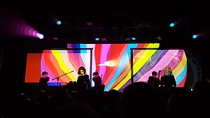 Ladytron performing in 2018; left to right: a touring member, Mira Aroyo, Daniel Hunt, Reuben Wu, and Helen Marnie