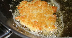 Potato pancake - Frying latkes at home for Hanukkah