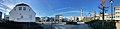 Leirvik town on Stord Island, Norway. Hagerupshuset kafé, Stord town hall (rådhus), parked cars, town square, radio mast tower (antennetårn radiolinjetårn), etc. Compressed, distorted panorama 2018-03-10.jpg
