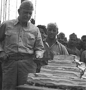 Harry B. Liversedge - Col Liversedge and his Marine Raiders, cutting the cake during their 1943 celebration of the Marine Corps birthday.