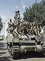 Local children crowd aboard a Sherman Mk III tank of the County of London Yeomanry in the village of Belpasso near Catania in Sicily, August 1943. TR1244.jpg