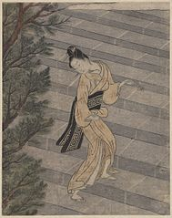 Young Woman Climbing Stone Stairs to a Shinto Temple