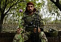MPOTY 2012 Afghan National Army soldier with poppy.jpg