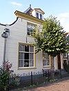 foto van Bakstenen gepleisterd huis