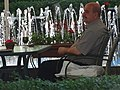 Man in Cafe with Fountains - Central Yerevan - Armenia (18955424302).jpg