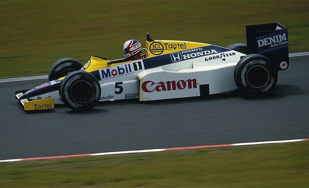 1200px-Mansell_-_Williams_1985.jpg