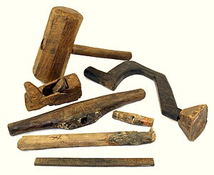 Tool - Carpentry tools recovered from the wreck of a 16th-century sailing ship, the Mary Rose. From the top, a mallet, brace, plane, handle of a T-auger, handle of a gimlet, possible handle of a hammer, and rule.