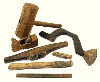 Drill - A wooden drill brace and other carpentry tools Including a plane, spokeshave, and rudimentary ruler) found on board the 16th century warship Mary Rose