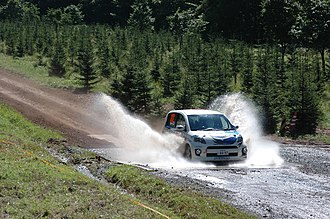 Rally Japan - A Daihatsu competitor during a stage in Rikubetsu in 2006.