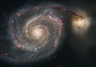 Unbarred spiral galaxy - The Whirlpool Galaxy and its companion satellite. The Whirlpool is an unbarred spiral galaxy