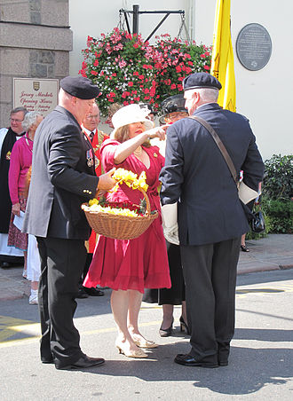Minden Day - The presentation of roses to commemorate Minden Day in Saint Helier, Jersey - a plaque recording Jersey's association with the Battle of Minden can be seen in the background