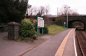 Minffordd railway station - Looking south along the National Rail platform. The southern end, beyond the bridge is disused. To the left is the ramp to the subway under the Ffestiniog Railway.