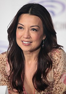 A close-up portrait of Mulan's voice actress, Ming-Na Wen, at a conference.